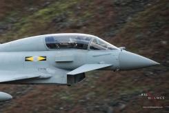 Dunmail Raise, Lake District, Cumbria, UK. 10th October 2017. XI Sqn Typhoon T3 ZJ802 low flying at Dunmail Raise.